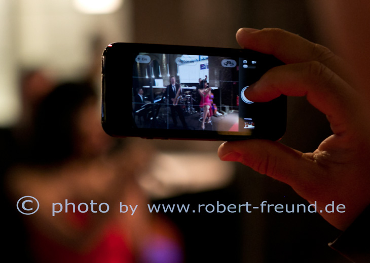 Fotograf Düsseldorf fotografiert das apple iPhone 5S in aktion als Fotograf beim Business Event im Capitol Düsseldorf